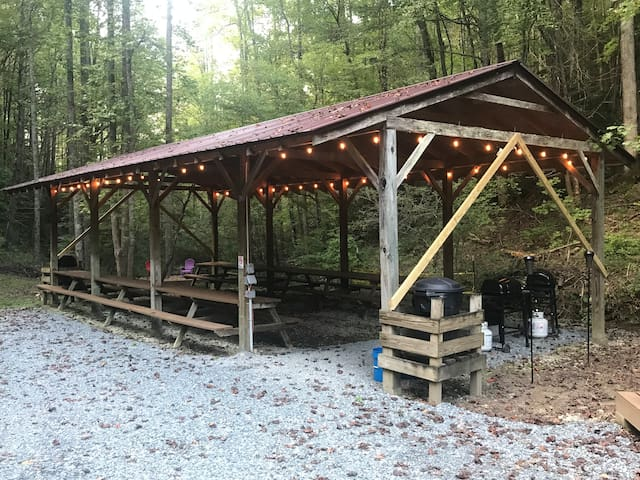 Food Pavillion. Here you can cook with your own camp stove, or ask us about our propane grills. It sits right next to the stream, and it's s great place to meet people!