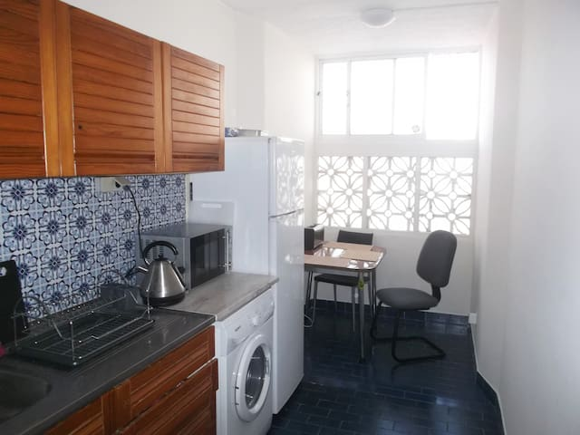 Large kitchen with gas stove, microwave, and plenty of storage space for guests' food.