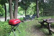 Bbq, table and chairs overlooking the Mohawk tributaries are for guest use.
