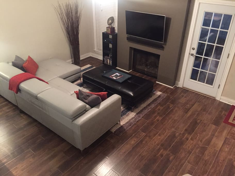 Living Area w/ Access to Private Patio