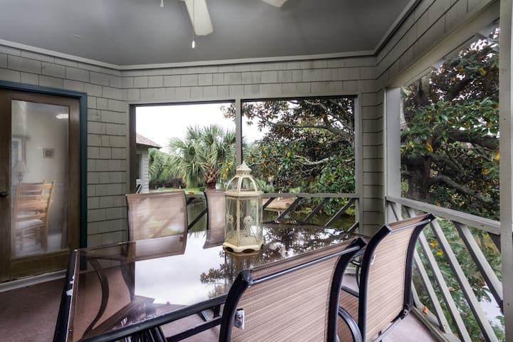 Screened porch with lagoon view