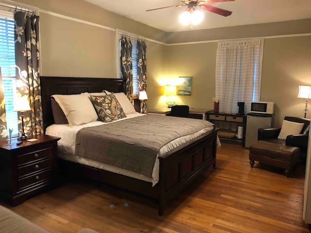 A spacious bedroom with a king size bed, with plenty of room to relax and work.