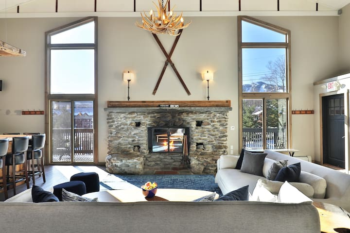 Relax by the fire while enjoying mountain trail views!