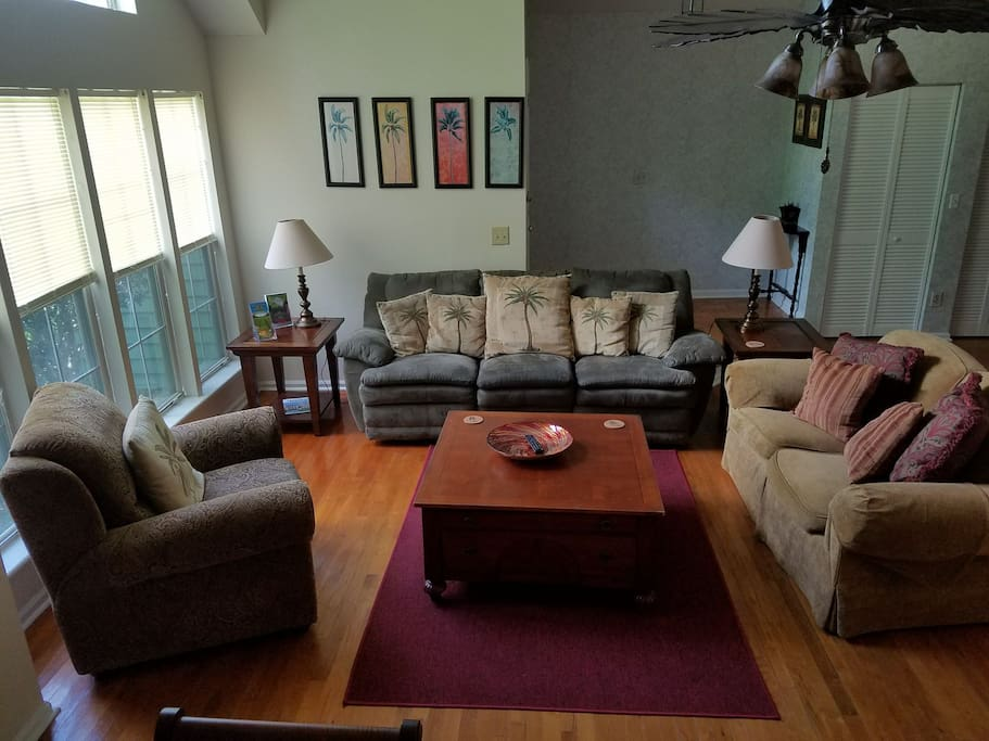 Living room seating with reclining couch, loveseat & reclining comfy chair.