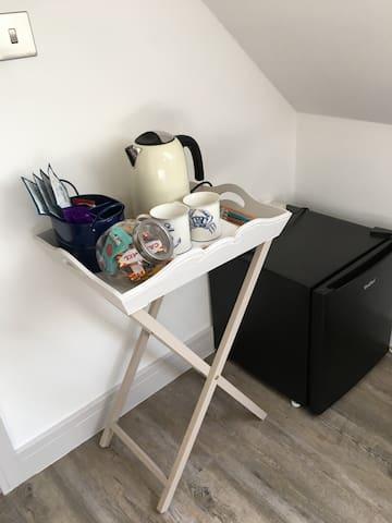 Tea, coffee, chocolate and biscuits and mini fridge