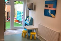 The playroom leading out into the outdoor play area