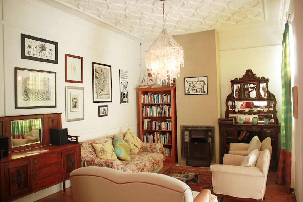 The living room comfortably seats eight. There are lots of great books and original art by local artists.
