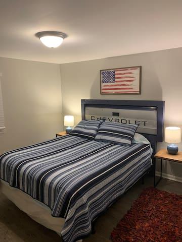Bedroom 2:  Chevrolet Queen bed and smart TV.