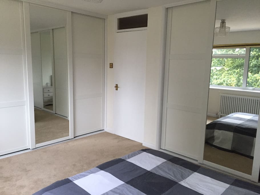 Spacious double bedroom with new wardrobes, fridge and dining area.
