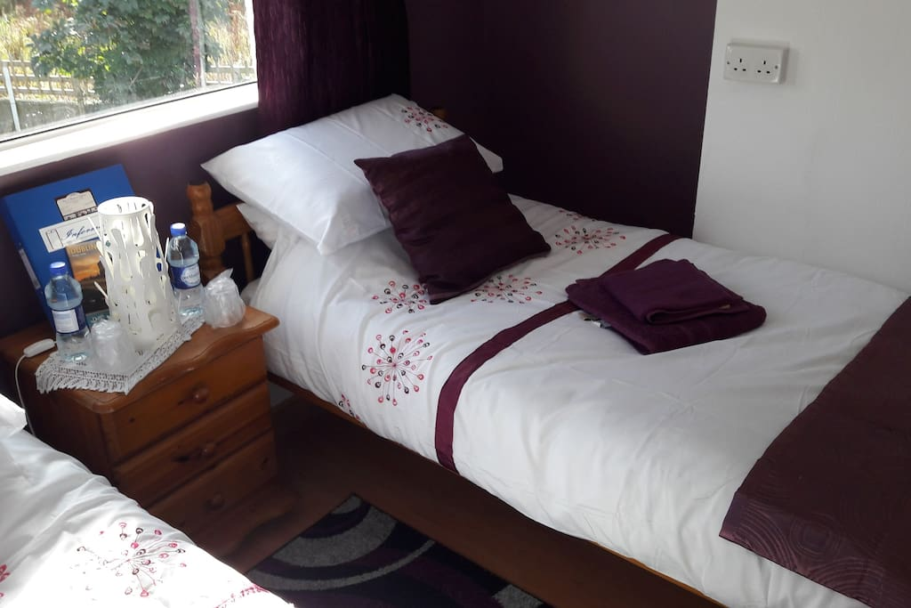Twin bedroom with wardrope, lockers, mirror and wifi