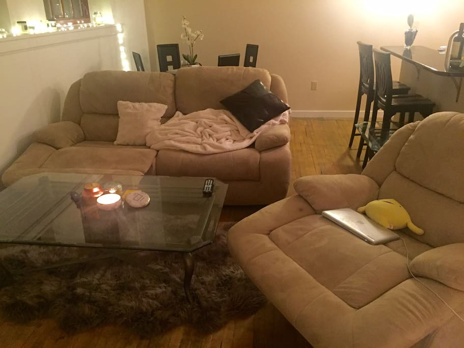 Genuine sheepskin rug in living room, comfortable couches
