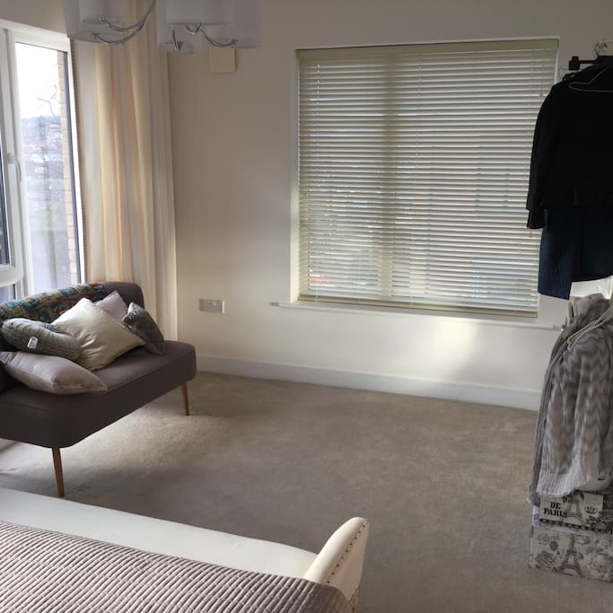 Extra space in bedroom with rail for clothes.