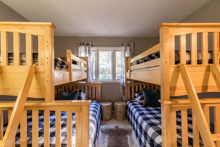 Bunk room off of living room features 1 double bed and 3 twin beds