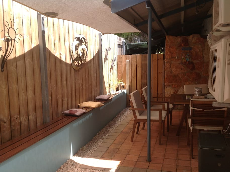 Shaded and private, the outdoor area included a BBQ and a fan