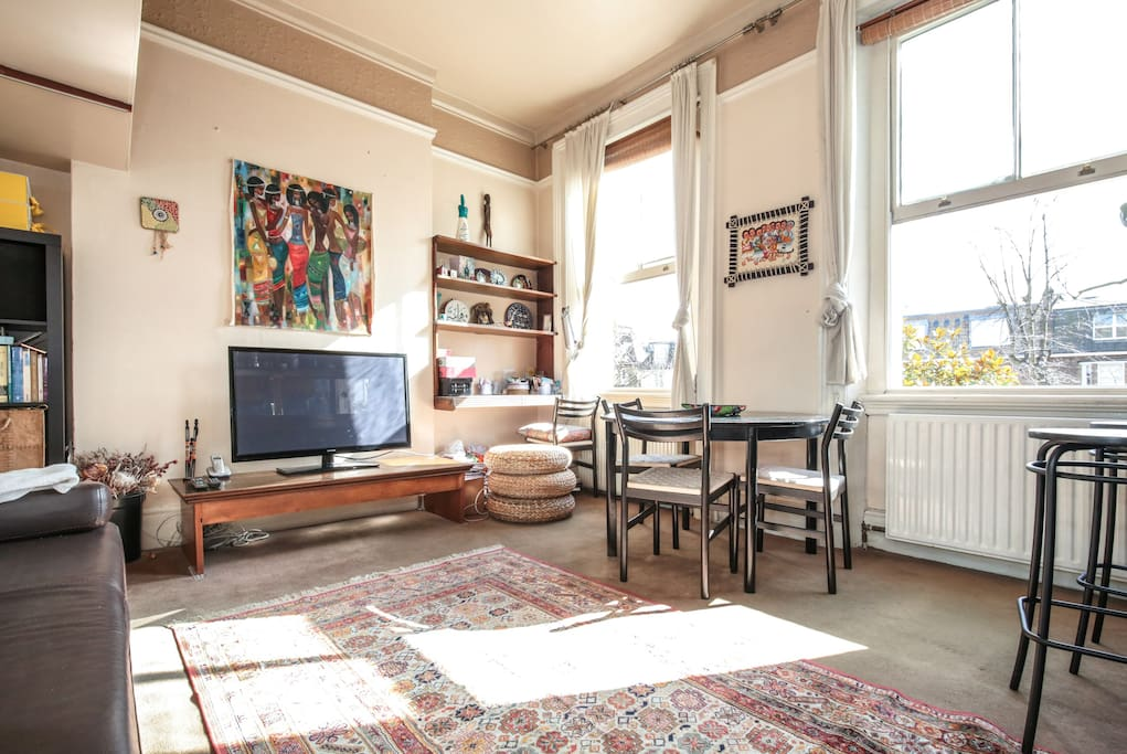Lots of sunlight during the day, with big windows overlooking the garden, and high ceiling. Oh and a decent size TV too.