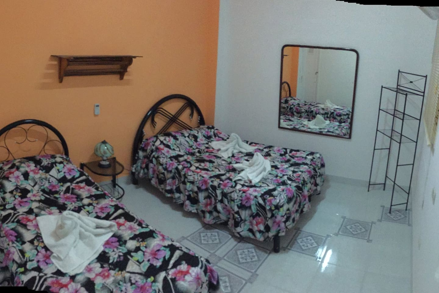 Room 2 bed, private bathroom, window, ac, fan. The entire apartment for you. We have 2 more rooms for renting in the apartment.