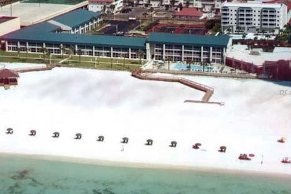 Arial view of the beach front at Holiday Beach Resort.  This unit for rent is on the front, second floor 4th from the left of this picture.
