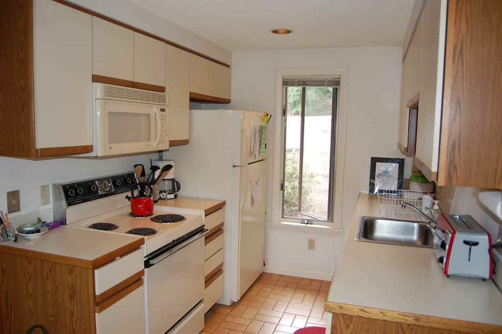 Fully-stocked kitchen, includes stove, oven, fridge-freezer, microwave, coffee makers (Keurig & drip), dishwasher, disposal