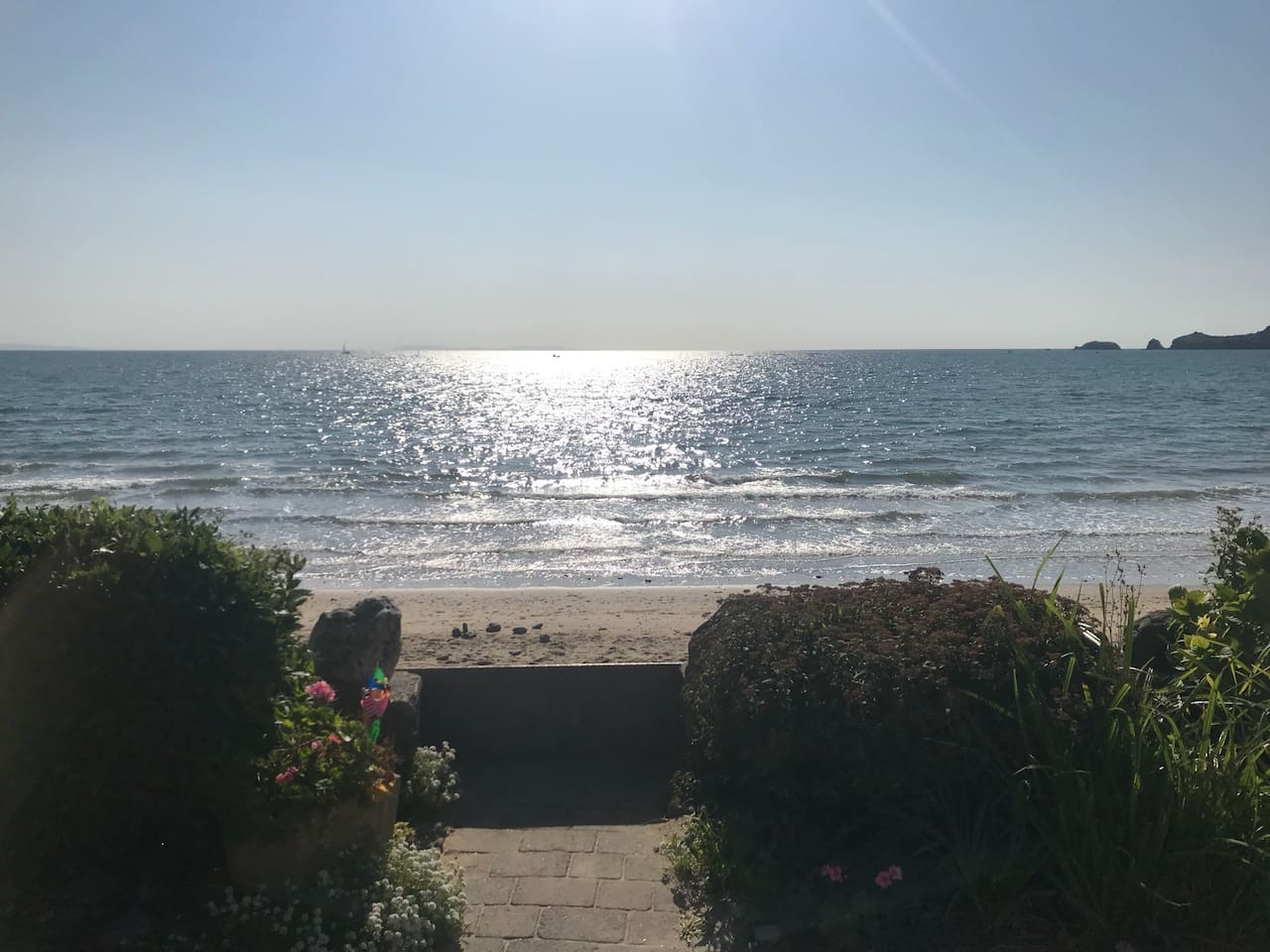 View from the garden at high tide.  The sea will go out as far as the rock on the right!  During high tides it will come so high, that you can throw pebbles into the sea.