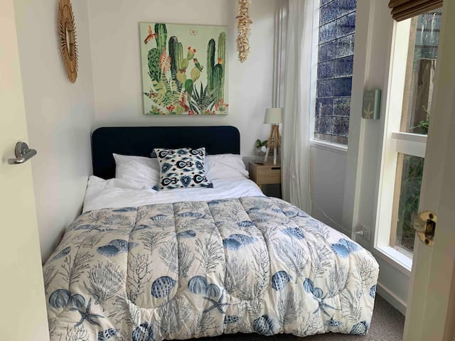 Cosy little bedroom with a double bed.