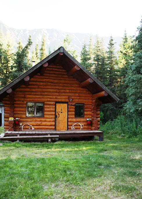 View of the outside of the log cabin.