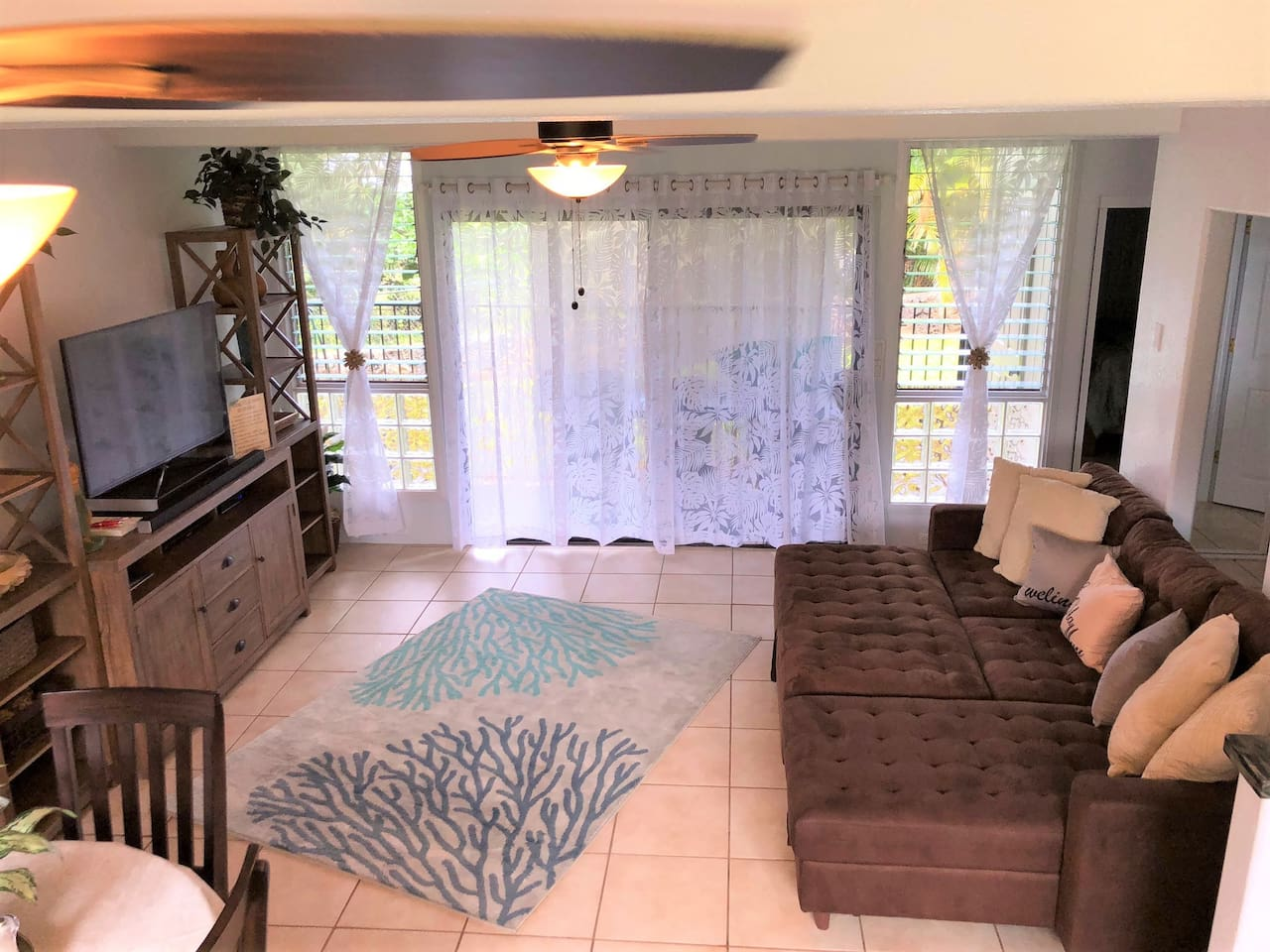 Comfortable LR area with large flat screen.Sofa is not a pull out bed but offers firm sleeping & lots of room for two people.Separate sectional components or place together for your desired sleeping arrangements.Extra linens & pillows are provided.