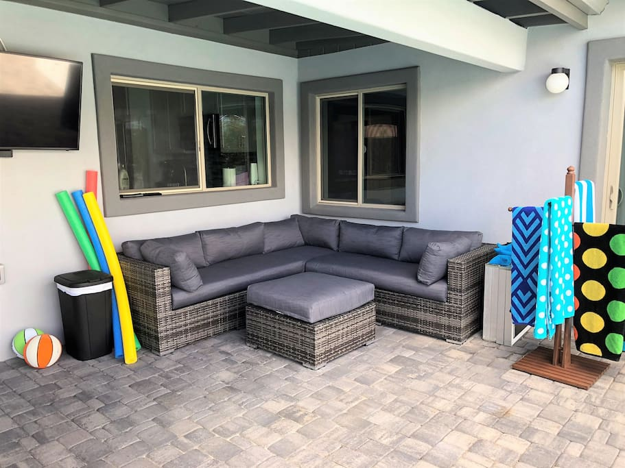 Outdoor sectional facing the pool