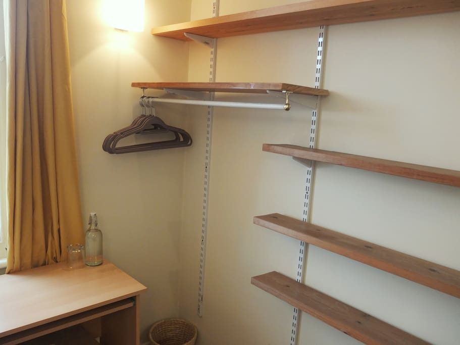 Shelves & plenty of space to hang clothes