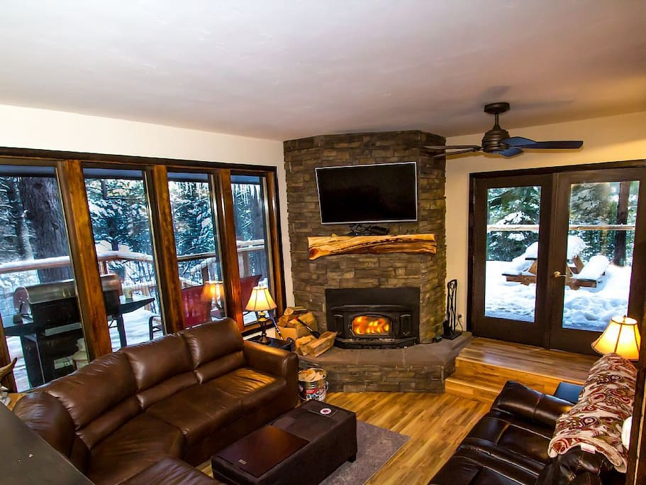 Cozy living room with fireplace and TV!