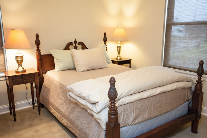 Our bedroom #2 with a cozy queen bed, luxury linens and closet
