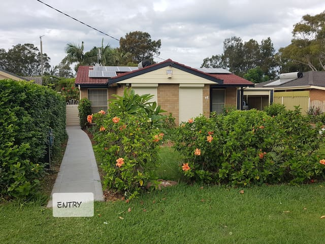 To make your arrival a bit easier, this is the frontage of the house and on the left-hand side your privet entrance and exit from and to the Studio. Just walk through the gate for 15 mitres and you'll see the studio at the end of the Back yard.