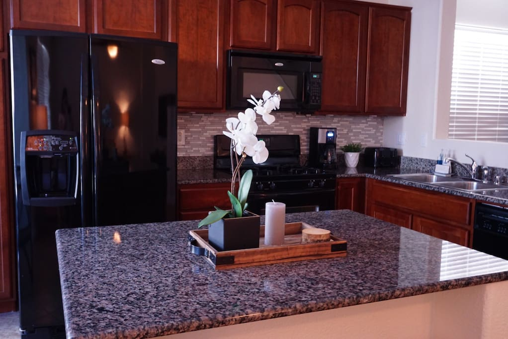 Kitchen: A home away from home, the kitchen has a toaster, rice cooker, and it's stocked with cookware and dinnerware. We provide paper towels, dish-washing soap, and dish-washer soap as well.