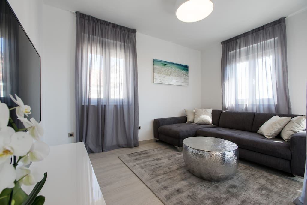 Living area with sofa bed for 2 people and 55'' smart TV. A/C and wifi are free and available in the whole property!