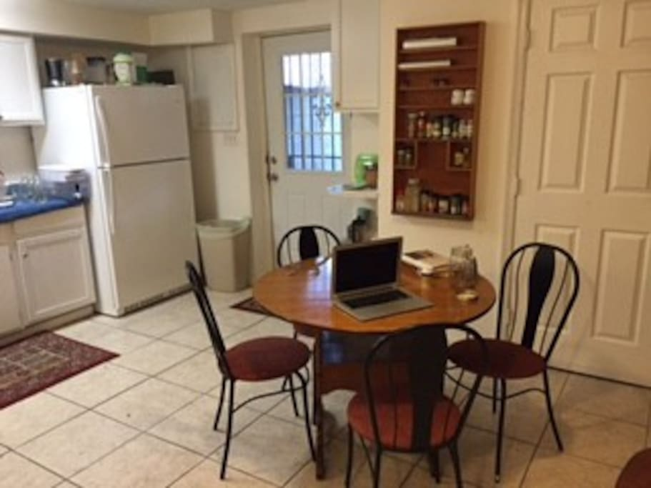 Dining area in the kitchen. Seats four people comfortably, with the option to add more chairs for more guests.