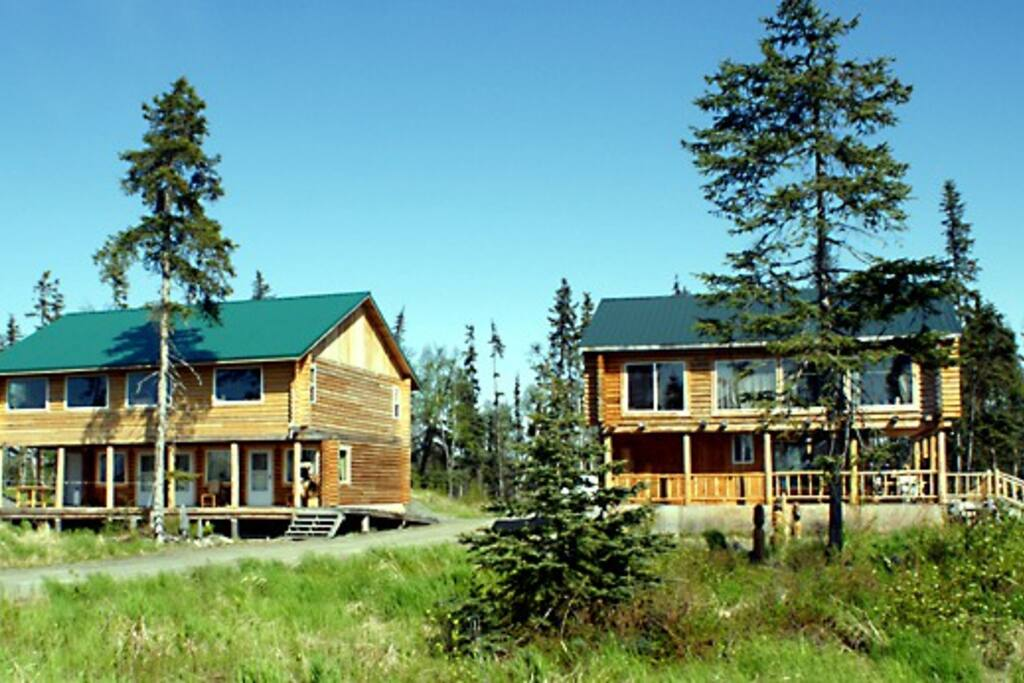 2 beautiful, hand built log lodges furnished with custom hand crafted log furniture in each room! Incredible scenery out the front door of Cook Inlet and the Mountains. Centrally located between Ninilchik and Homer.