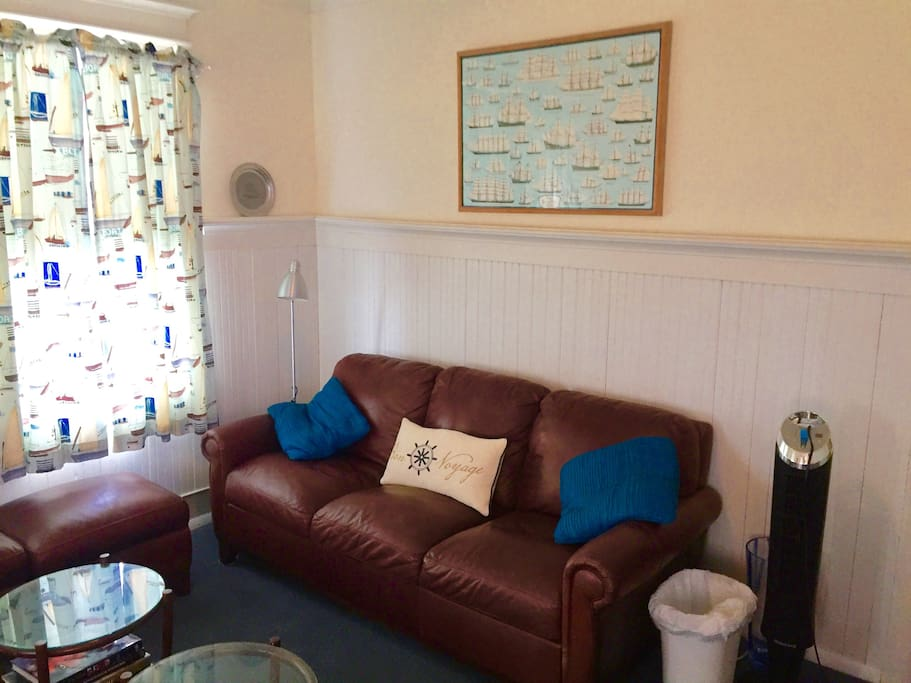 Two leather sofas with 42 flat screen