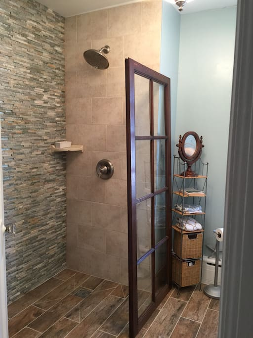 Newly Remodeled Upstairs full bathroom with walk-in shower.
