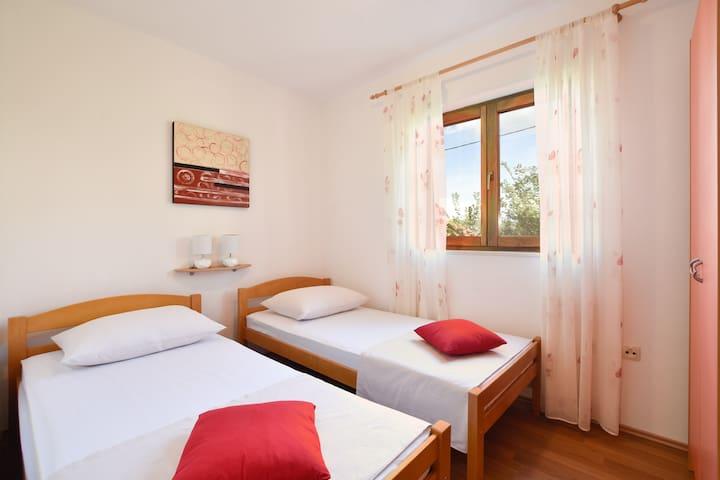 Dvokrevetna spavaća soba