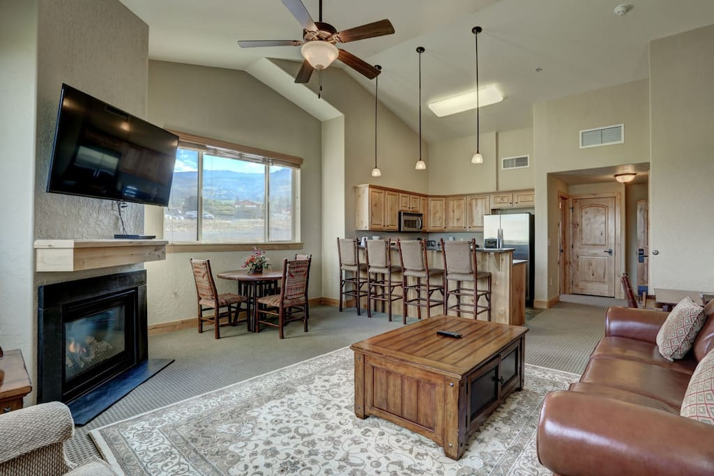 """Living Room with 55"""" HD Smart TV, Gas Fireplace, Sofa Sleeper and Deck Access"""