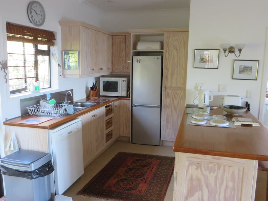 Kitchen with microwave, stove, oven, dishwasher and fridge