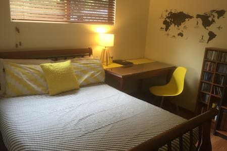 Sunny Yellow double bedroom awaits - House