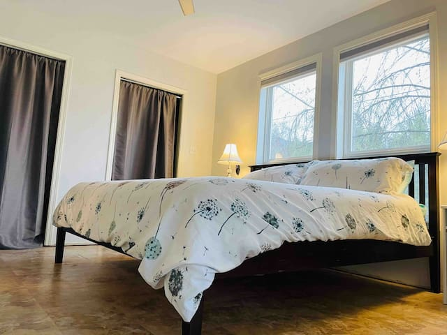Beautiful master bedroom with a King Size Bed.  Great windows that make you feel like you are in a tree house and french doors that lead you to the outside wrap around deck.