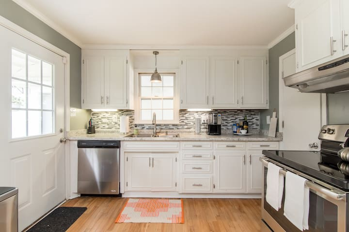 Light, bright kitchen, equipped with all your basic necessities.