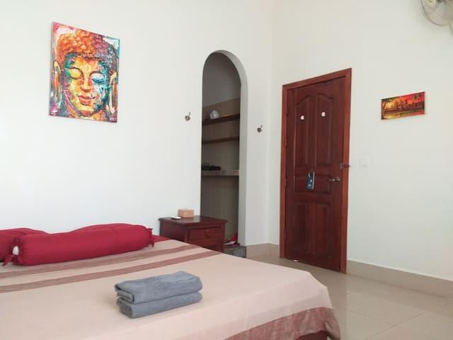 Main room, kitchenette access, main door of the room