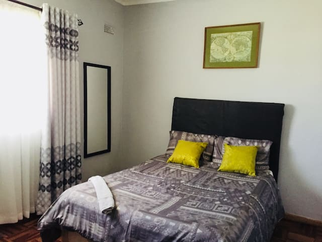 """Ruvimbo Gardens """"Green"""" Standard Room"""