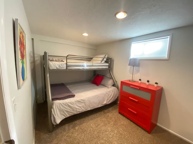 Small room with a twin bed and a small full bed