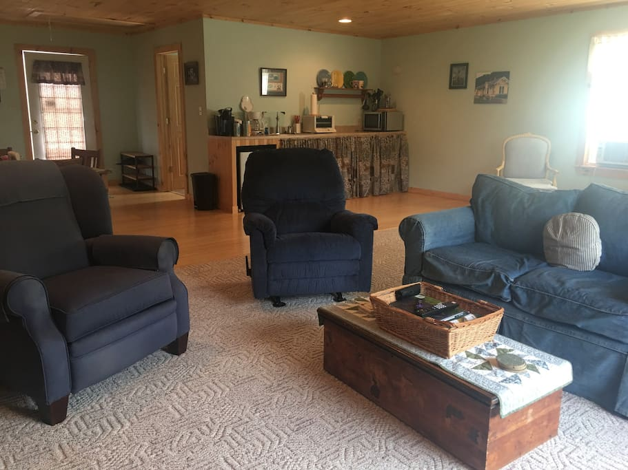 Living space with two recliners, love seat.  Relax and enjoy Netflix, prime, and other channels on the ROKU.