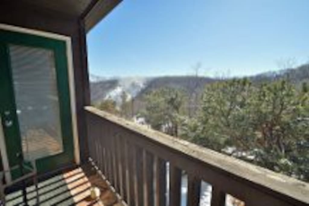 Balcony that is accessible from the living room or master bedroom with views of the mountains and ski slopes.