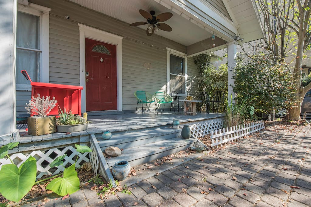 Ample amount of space on porch with several options for seating. Includes a retro glider, CB2 lounge chairs and metal Italian chairs.