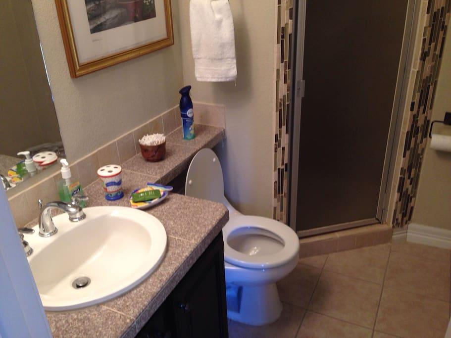 Private, en suite bathroom with shower
